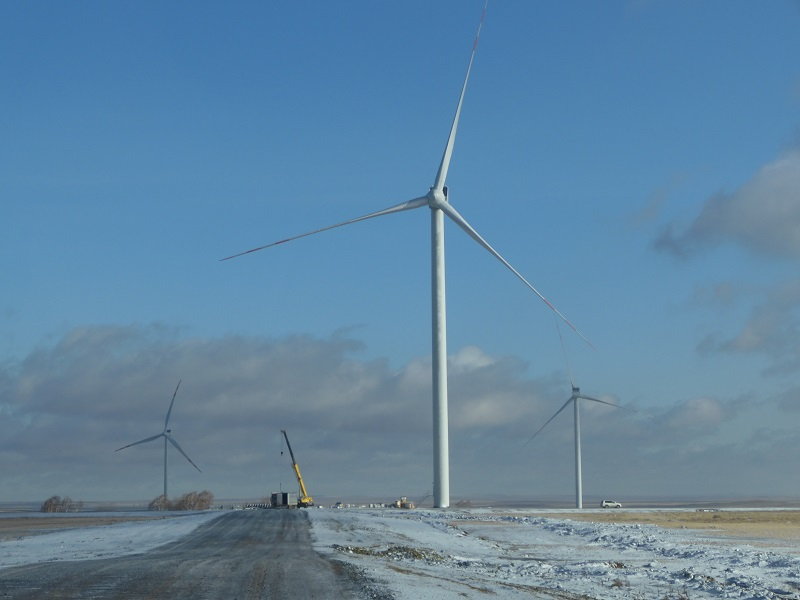 Wind Turbines and crane in the snow